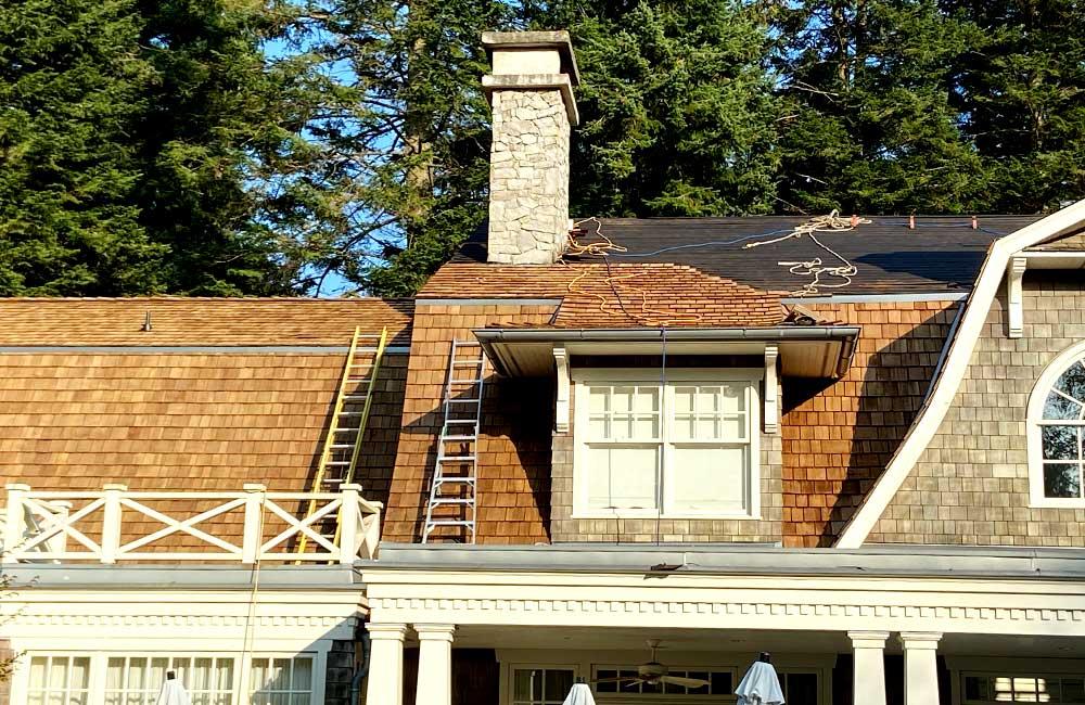 Cedar roof on stone house construction