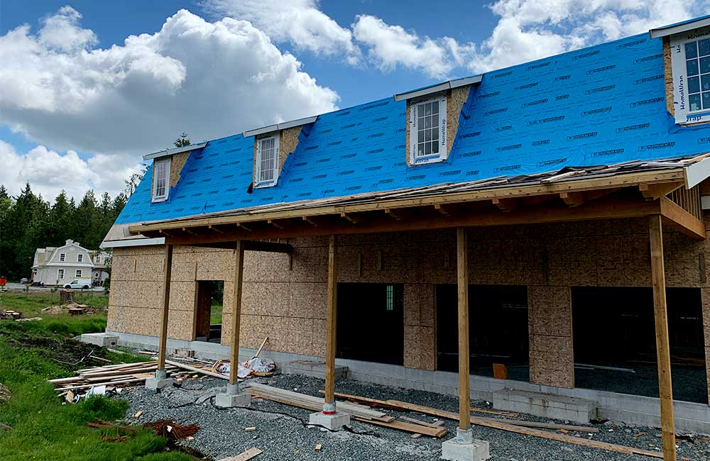 Metal roof on new barn construction